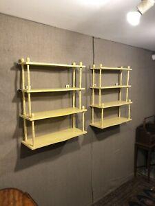 Pair of yellow painted mahogany wall shelves