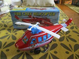 "NEUF RARE ""PETIT HELICOPTERE MECANIQUE FIRE CHIEF HELICOPTER"" encore en boite"