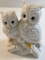 "Ceramic owls mom and baby with yellow feet sitting on a log 5""  tall.  (h)"