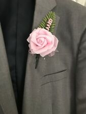 Pink Rose Button Hole With Fern ,Ribbon And Twirl.