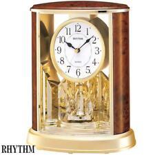 Rhythm 7724/20 Orologio da tavolo al quarzo analogico con pendolo rotante Golden