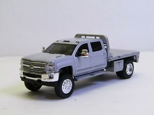1/64 Dcp/Greenlight Custom lifted silver Chevy 3500 crew cab flatbed no box