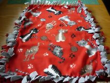 Handmade fleece tie blanket of cats on red for a small pet