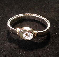 Helbros Oval Face Gold and Silver Tone Stretch Band Wrist Watch 2 inch Diameter