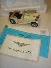 A Franklin mint scale model car of a 1938 Jaguar SS100. Boxed & paperwork