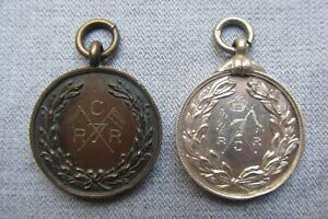 Royal Canadian Regiment -- Two Fobs -- One Bronze - One Silver -- WW1 / Military