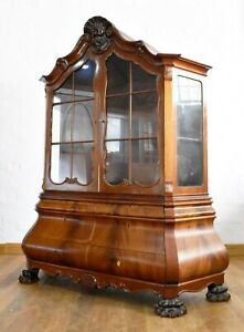 Very large carved flame mahogany double Bombe display cabinet