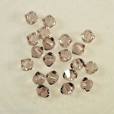50 perles  toupies en cristal de Swarovski  5328 Light Amethyst 4 mm