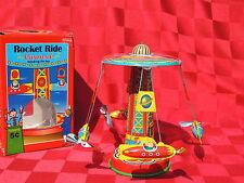 Jouet mécanique en tôle. CARROUSEL ROCKET RIDE. Wind-up Tin Toy.  21 cm. NEUF
