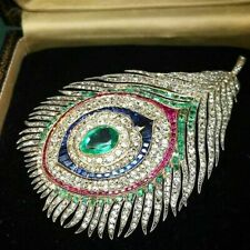 Peacock feather brooch Art Deco peacock brooch set with diamonds and emeralds
