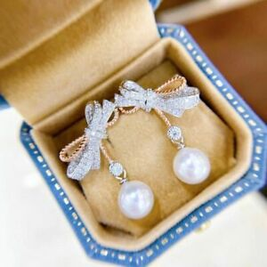 charming 10-11mm south sea round white pearl earring 925s(mj)
