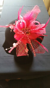 Fascinator - Pink sinamay with flower, feathers and beads mounted on a headband