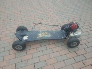 skateboard gas powered 2 stroke gas engine. NOT RUNNING