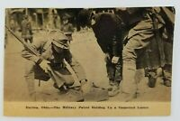 Postcard 1913? Flood Military Soldier Holding Up a Looter Thief Dayton Ohio