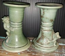 Pair of pottery candle holders. Handmade in Thailand. Decades old. Peek-a-boo!