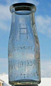 Half-pint wide-necked milk bottle from HAMPSON, STRETFORD.