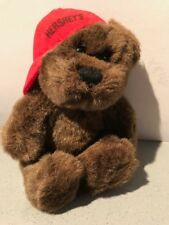 Hershey's dark brown fluffy teddy with red baseball cap