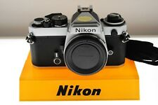 Nikon FE silver auto/manual Pro SLR. MINT- condition +strap. Classic!