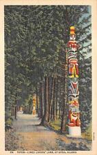 TOTEM POLES LINED LOVERS LANE AT SITKA ALASKA POSTCARD (c. 1940s)