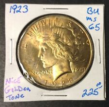 1923 $1 Peace Dollar BU++ Condition with Golden Toning