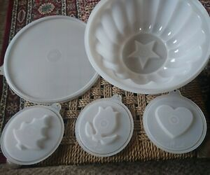 Complete vintage Tupperware jelly mould set with 4 interchangeable inserts