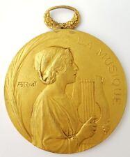 """Médaille en Bronze """"La musique """" les Voix de Antibes 1930. (AV599)"""