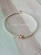 Sterling Silver and Rose Gold Bead Stacking Bracelet