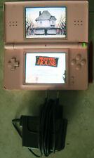Consola Nintendo DS Lite Rosa + Cargador y Juego Monster House. Funciona.