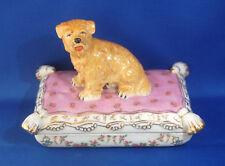 A lovely antique porcelain Cairn Terrier dog figure on cushion trinket box