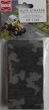 BUSCH 1105 Potholed Street (Self Adhesive) 1m x 66mm 00/HO