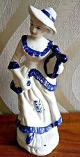 Porcelain woman figurine playing harp  blue and white