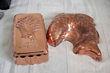 2 Copper molds depicting a harvest wreath and a fish