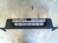 NEW OEM 2002-2004 NISSAN XTERRA FRONT GRILLE ASSEMBLY - GREY IN COLOR