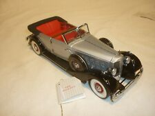 A Franklin mint scale model of a 1934 Packard Convertible, Limited edition 9500