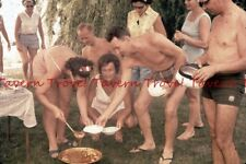 Lot of TWO 1964 Shirtless Hungarians dipping goulash at a picnic 35mm Slide c651