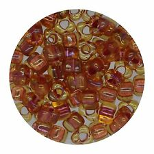 Japanese Glass Triangle Bead 5/0 Lined Amber Shimmering Pink Ab