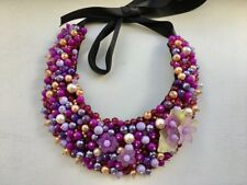 Handmade statement necklace made of beads hand-sewn on felt