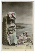 c 1909 Young Mother in Wicker Beach Chair GIRL PLAYING IN SAND photo postcard