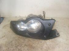 2009 Kawasaki Brute Force 650 Right headlight and bezel.