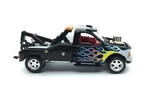 Johnny Lightning Rebel Rods Tow-Nado 2000 Ford F-550 Tow Truck Black 1/64 Loose