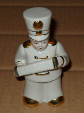 White and Gold china figure of Military Uniformed Concertina Player