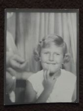 YOUNG GIRL WITH BAND AID ON FACE, HAND REACHING IN FROM SIDE, 1963 PHOTO BOOTH