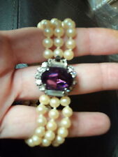 LUSH RETRO  TRIPLE STRAND FAUX PEARL BRACELET WITH AMETHYST CRYSTAL FOCAL CLASP
