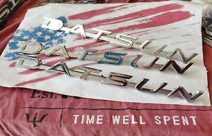 Datsun 510 1600 bluebird, metal fender & trunk emblems with barrel nuts