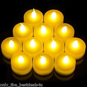 12 x FLICKERING LED TEA LIGHT CANDLES TEALIGHT TEA LIGHTS WITH BATTERIES NEW