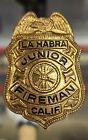 LA HABRA JUNIOR FIREMAN BADGE/ METAL GOLD COLOR