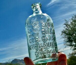 "ca 1900 CRUDE EMBOSSED ""MARTIN & MARTIN STOVE POLISH"" AQUA GLASS ILLINOIS BOTTLE"