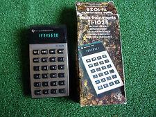TEXAS INSTRUMENTS TI-1025 CALCULATOR RETRO GREEN LCD 80's INCLUDES BOX