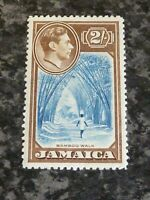 JAMAICA POSTAGE STAMP SG131 2/- BLUE & CHOCOLATE LIGHTLY MOUNTED MINT