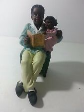 African American Chiefly figurine of dad reading to daughter